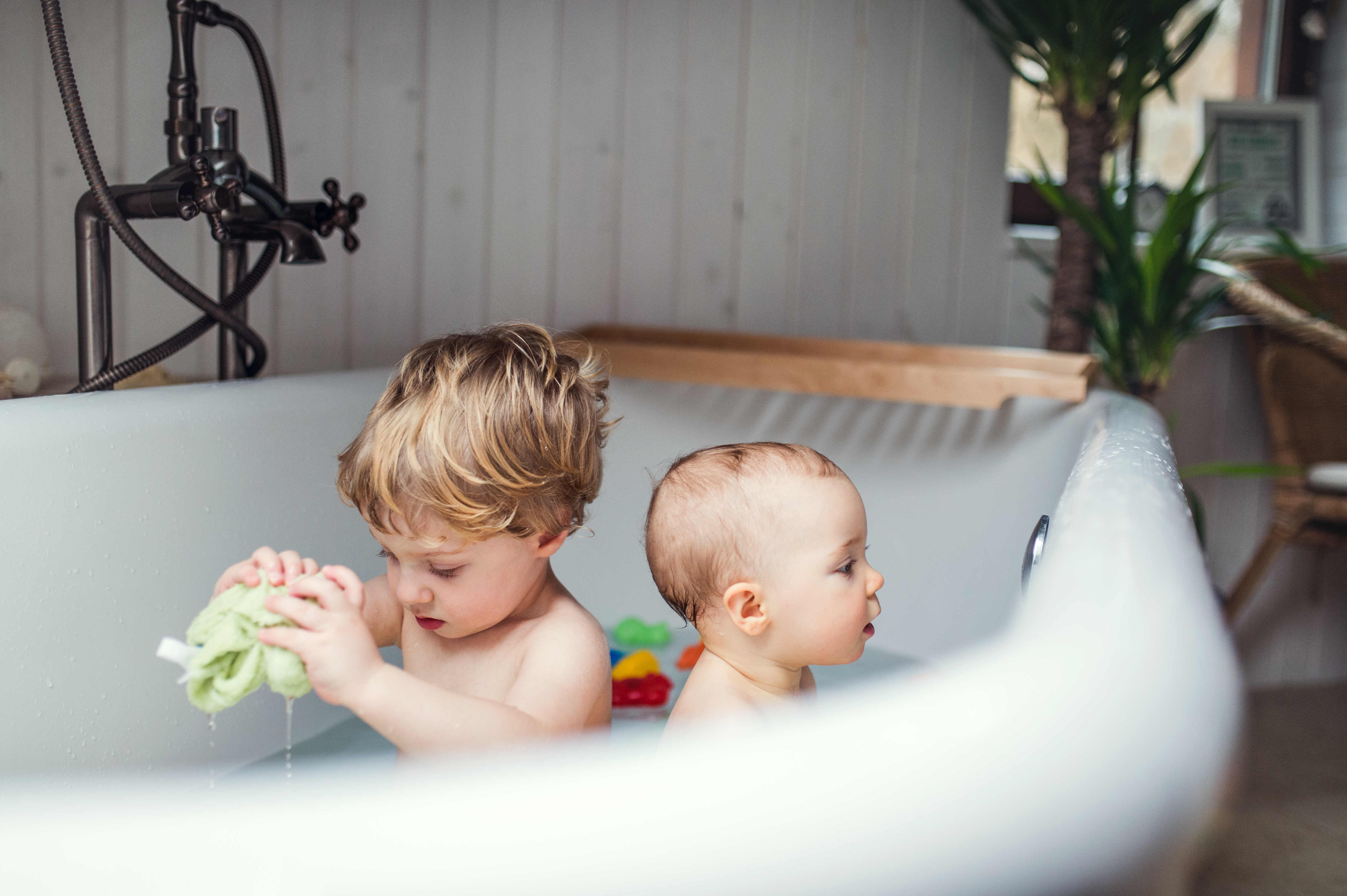 Two Toddler Children Having A Bath